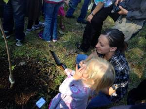 My niece and I helping to plant the tree