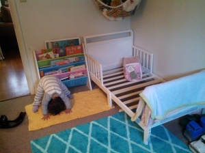 New toddler bed (mattress coming tomorrow) and my girl practicing her gymnast moves