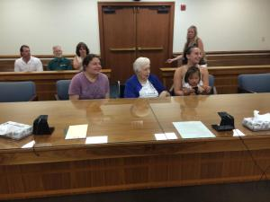 My mom, Grandma, M and I listening to the judge