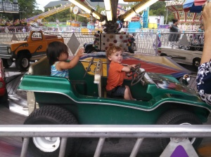 Riding all by herself for the first time (with random toddler I was hoping would model good ride behavior for her)