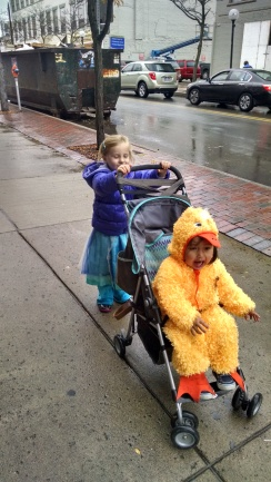 "My niece ""Elsa"" pushing her cousin the deck to the next store for trick-or-treat"