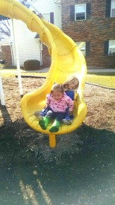 A being a great big sister and helping M on the slide
