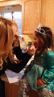 Getting her face painted by Auntie