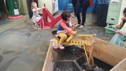 Girls operating heavy machinery