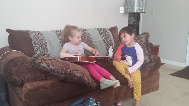 Jamming on grandpa's guitar